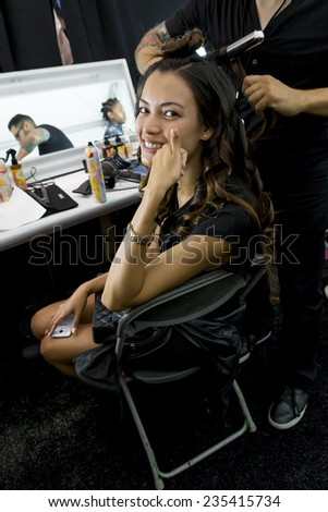New York - September 04, 2014: Angela Ruiz prepares backstage at the Desigual Spring 2015 fashion show during Mercedes-Benz Fashion Week at The Theatre at Lincoln Center