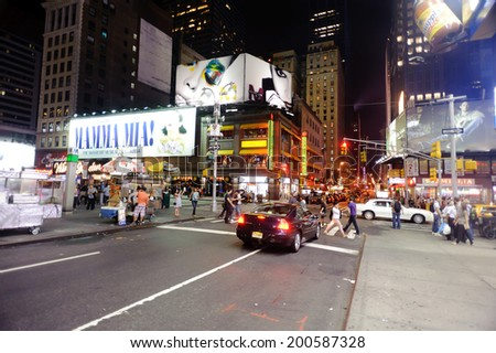 NEW YORK - SEPTEMBER 25: area near Times Square at night on September 25, 2011 in New-York. Times Square is a major commercial intersection and a neighborhood in Midtown Manhattan, New York City. - stock photo