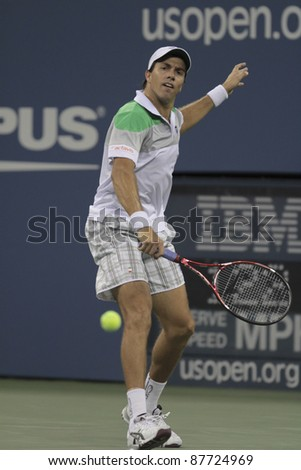 NEW YORK - SEPTEMBER 01: Carlos Berlocq of Argentina returns ball during 2nd round match against Novak Djokovic of Serbia at USTA Billie Jean King National Tennis Center on September 01, 2011 in New York City, NY.