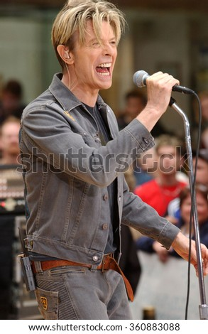 NEW YORK - SEPTEMBER 18, 2003: David Bowie performs on NBC's Today Show at Rockefeller Plaza on September 18, 2003 in New York City. - stock photo