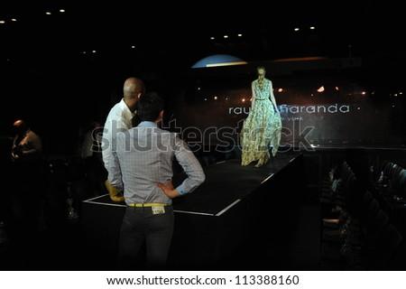 NEW YORK- SEPTEMBER 13: Designer Raul Penaranda and model at the Raul Penaranda rehearsal at XL club for S/S 2013 during NY Fashion Week on September 13, 2012 in New York City, NY - stock photo