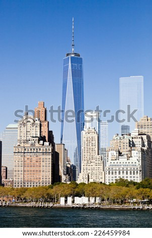 NEW YORK - SEPTEMBER 27: Freedom Tower in Lower Manhattan on September 27, 2014. One World Trade Center is the tallest building in the Western Hemisphere and the third-tallest building in the world - stock photo
