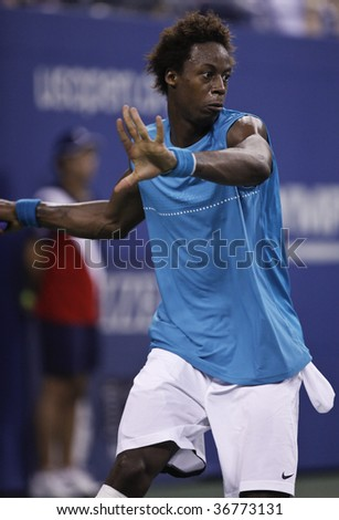 NEW YORK - SEPTEMBER 8: Gael Monfils of France reacts a shot during 4th round match against Rafael Nadal of Spain at US Open on September 8, 2009 in New York