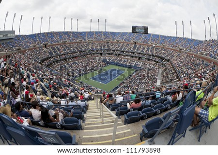 NEW YORK - SEPTEMBER 2: General view of Arthur Ash stadium during 4th round match between Novak Djokovic of Serbia and Julien Benneteau of France at US Open tennis tournament on Sep 2, 2012 in NYC - stock photo
