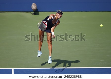 NEW YORK - SEPTEMBER 2, 2014: Grand Slam champion Elena Vesnina from Russia during quarterfinal doubles match at US Open 2014 at National Tennis Center in New York - stock photo