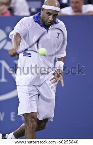 NEW YORK - SEPTEMBER 02: James Blake of USA returns ball during second round match against Peter Polansky of Canada at US Open tennis tournament on September 02, 2010, New York.