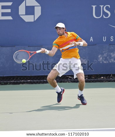 NEW YORK - SEPTEMBER 1: Jeremy Chardy of France returns ball during 3rd round match against Martin Klizan of Slovakia at US Open tennis tournament on September 2, 2012 in Flashing Meadows New York