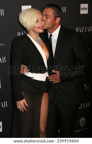 NEW YORK - SEPTEMBER 5: Lady Gaga and Taylor Kinney attend the Harper's Bazaar ICONS event at the Plaza Hotel on September 5, 2014 in New York City. - stock photo