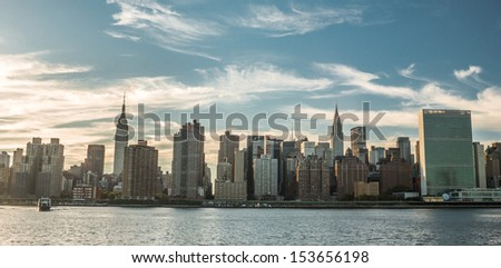 NEW YORK - SEPTEMBER 9: Manhattan Skyline on september 9, 2013 in New York. The most populous of the five boroughs, Manhattan contains some of the most sought after real estate in the city. - stock photo