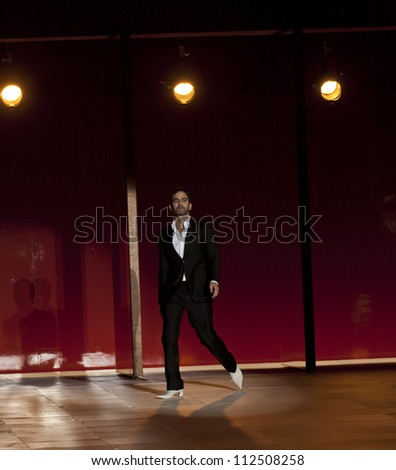 NEW YORK - SEPTEMBER 10: Marc Jacobs walks the runway for Marc Jacobs Collection during Spring/Summer 2013 at Mercedes-Benz Fashion Week in Lexington Armory on September 10, 2012 in New York