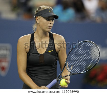 NEW YORK - SEPTEMBER 2: Maria Sharapova of Russia returns ball during 4th round match against Nadia Petrova of Russia at US Open tennis tournament on September 2, 2012 in Flushing Meadows New York