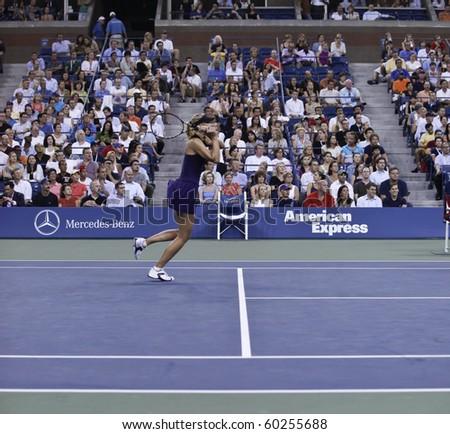 NEW YORK - SEPTEMBER 02: Maria Sharapova of Russia returns the ball during second round match against Iveta Benesova of Czech Republic at US Open tennis tournament on September 02, 2010, New York. - stock photo