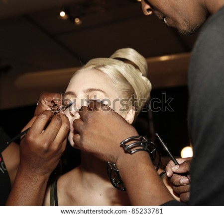 NEW YORK - SEPTEMBER 13: Model preparing backstage for runway collection by Zang Toi at Mercedes-Benz Spring/Summer 2012 Fashion Week on September 13, 2011 in New York City