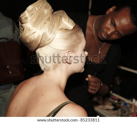 NEW YORK - SEPTEMBER 13: Model preparing backstage for runway collection by Zang Toi at Mercedes-Benz Spring/Summer 2012 Fashion Week on September 13, 2011 in New York City - stock photo