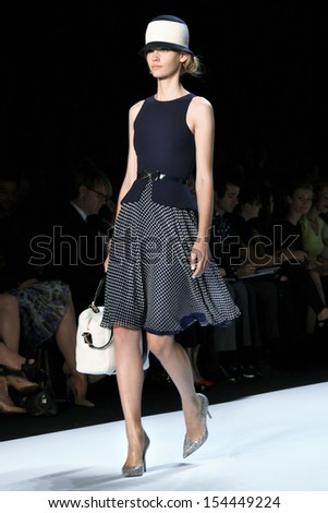 NEW YORK - SEPTEMBER 10: Model walks the runway at the Badgley Mischka Spring Summer 2014 Collection presentation during Mercedes-Benz Fashion Week on September 10, 2013 at Lincoln Center in New York - stock photo