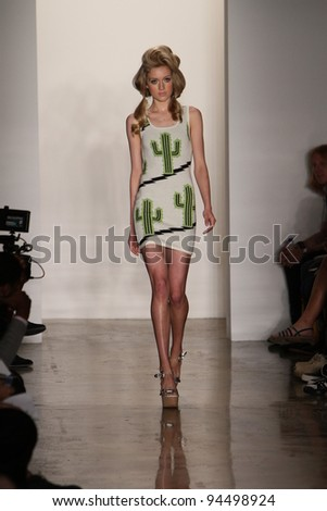 NEW YORK - SEPTEMBER 14: Model walks the runway at the Jeremy Scott Spring/Summer 2012 collection during New York Fashion Week on September 14, 2011 in New York City. - stock photo