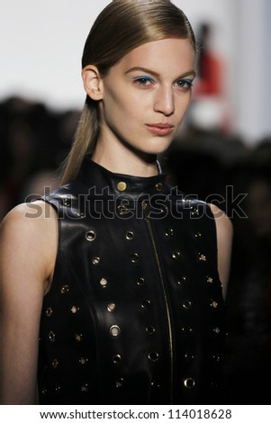 NEW YORK - SEPTEMBER 12: Model walks the runway at the Michael Kors S/S 2013 collection presentation during Mercedes-Benz Fashion Week on September 12, 2012 in New York. - stock photo