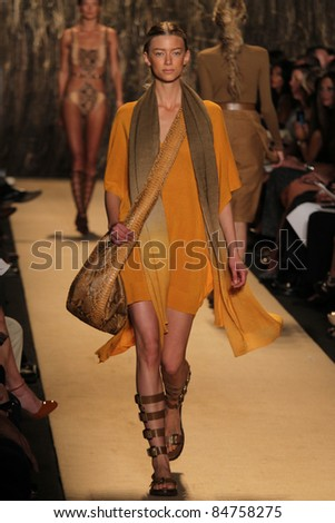 NEW YORK - SEPTEMBER 14: Model walks the runway at the Michael Kors S/S 2012 collection presentation during Mercedes-Benz Fashion Week on September 14, 2011 in New York. - stock photo