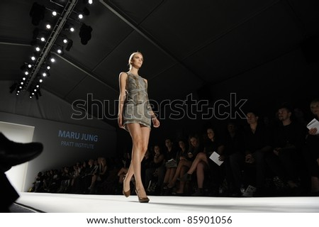 NEW YORK - SEPTEMBER 10: Model walks the runway at the SUPIMA Spring / Summer 2012 collection presentation during Mercedes-Benz Fashion Week on September 10, 2011 in New York. - stock photo