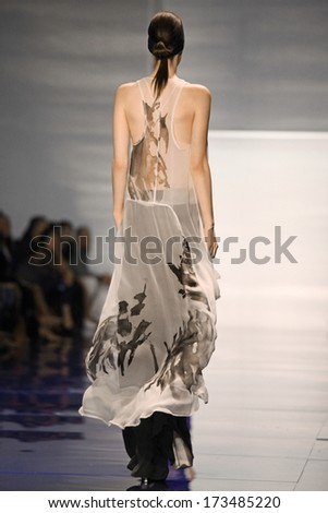 NEW YORK - SEPTEMBER 10: Model walks the runway at the Vera Wang Spring Summer 2014 Collection presentation during Mercedes-Benz Fashion Week on September 10, 2013 at Lincoln Center in New York. - stock photo