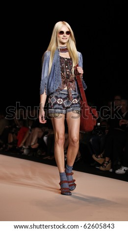 NEW YORK - SEPTEMBER 15: Model walks the runway for Anna Sui Collection on Spring/Summer 2011 during Mercedes-Benz Fashion Week on September 15, 2010 in New York - stock photo