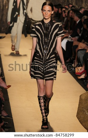 NEW YORK - SEPTEMBER 14: Model Zuzanna Bijoch walks the runway at the Michael Kors S/S 2012 collection presentation during Mercedes-Benz Fashion Week on September 14, 2011 in New York. - stock photo