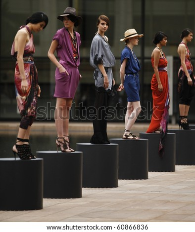 NEW YORK - SEPTEMBER 12: Models present dress for Catherine Malandrino Collection on Spring/Summer 2011 during Mercedes-Benz Fashion Week on September 12, 2010 at Lincoln Center Promenade in New York - stock photo