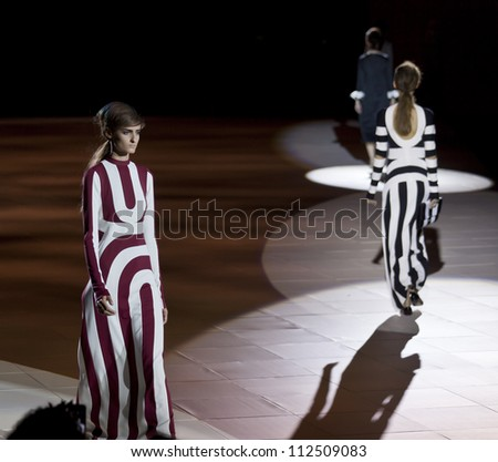 NEW YORK - SEPTEMBER 10: Models walk the runway for Marc Jacobs Collection during Spring/Summer 2013 at Mercedes-Benz Fashion Week in Lexington Armory on September 10, 2012 in New York