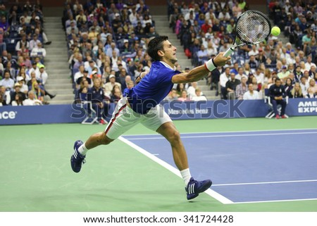 NEW YORK - SEPTEMBER 13, 2015: Nine times Grand Slam champion Novak Djokovic in action during men's final match at US OPEN 2015 with Roger Federer at Billie Jean King National Tennis Center in NY - stock photo