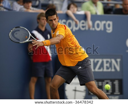 NEW YORK - SEPTEMBER 3: Novak Djokovic of Serbia returns a shot during 2nd round match against Carsten Ball of Australia at US Open on September 3, 2009 in New York. - stock photo
