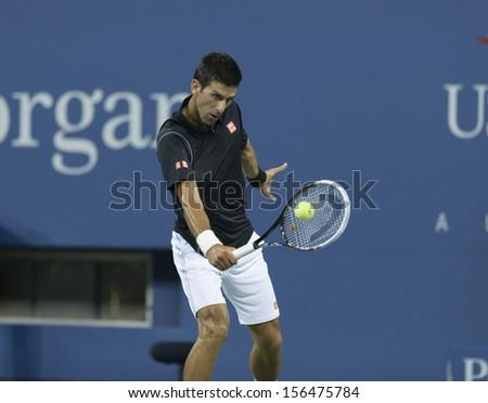 NEW YORK - SEPTEMBER 1: Novak Djokovic of Serbia returns ball during 3rd round match against Joao Sousa of Portugal  at USTA Billie Jean King Tennis Center on September 1, 2013 in New York CIty - stock photo