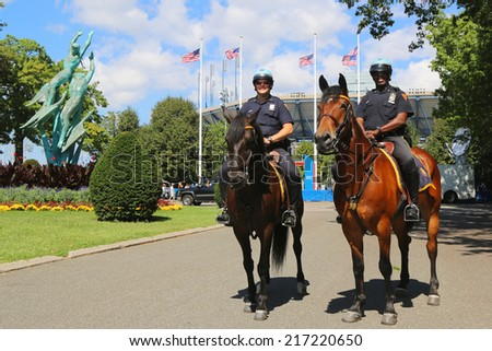 NEW YORK - SEPTEMBER 7 : NYPD police officers on horseback ready to protect public at Billie Jean King National Tennis Center during US Open 2014 on September 7, 2014 in New York - stock photo