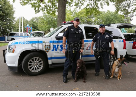 NEW YORK - SEPTEMBER 8: NYPD transit bureau K-9 police officers and K-9 dogs providing security at National Tennis Center during US Open 2014 on September 8, 2014 in New York - stock photo