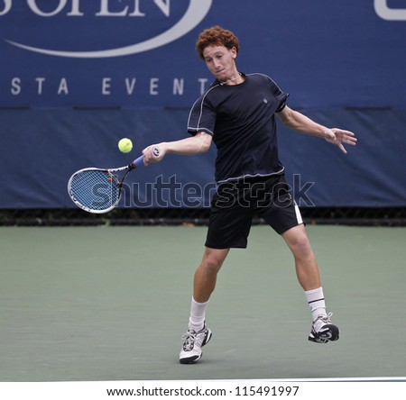 NEW YORK - SEPTEMBER 03: Or Ram-Harel of Israel returns ball during boys 1st round match against Mitchell Krueger of USA at US Open tennis tournament on September 3, 2012 in Flashing New York