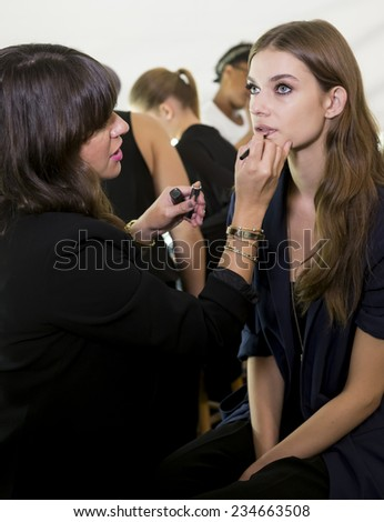 NEW YORK - SEPTEMBER 08, 2014: Oxana Zubko prepares backstage at the Dennis Basso Spring 2015 fashion show during Mercedes-Benz Fashion Week at The Theatre at Lincoln Center