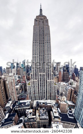 NEW YORK - SEPTEMBER 11, 2014: Panoramic view of Empire State Building with New York City Manhattan skyscrapers skyline on September 11, 2014 - stock photo