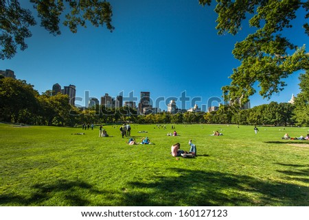 NEW YORK - September 24: People enjoying relaxing outdoors in Central Park on Sept. 24, 2013 in New York. The park is the most visited urban park in the United States with 35 million visitors annually