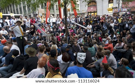 NEW YORK - SEPTEMBER 17: Protesters general assembly with 'Occupy Wall Street' movement mark one year anniversary of protest in Zuccotti Park on September 17, 2011 in New York. - stock photo