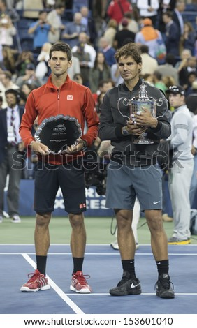 NEW YORK - SEPTEMBER 9: Rafael Nadal of Spain & Novak Djokovic pose with trophies after final match of US Open at USTA Billie Jean King National Tennis Center on September 9, 2013 in New York City