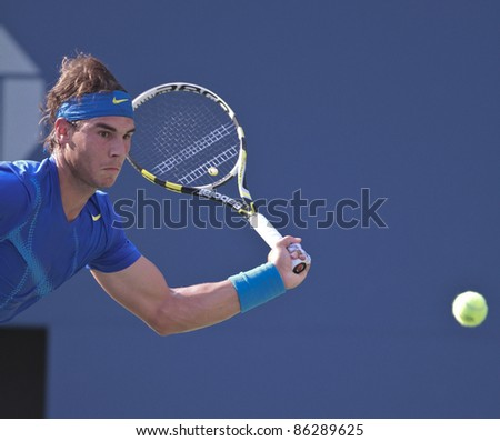 NEW YORK - SEPTEMBER 12: Rafael Nadal returns ball during final match against Novak Djokovic of Serbia at USTA Billie Jean King National Tennis Center on September 12, 2011 in NYC - stock photo