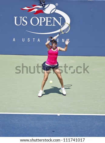 NEW YORK - SEPTEMBER 1: Roberta Vinci of Italy returns ball during 3rd round match against Dominika Cibulkova of Slovakia at US Open tennis tournament on September 1, 2012 in Flashing Meadows New York