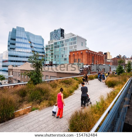 NEW YORK - SEPTEMBER 24: Scenic views along the High Line on September 24 2011. The High Line is a popular linear park built on the elevated train tracks above Tenth Ave in New York City. - stock photo