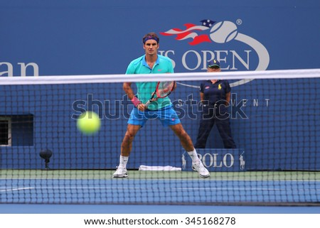 NEW YORK - SEPTEMBER 6, 2014: Seventeen times Grand Slam champion Roger Federer in action during semifinal  match at US Open 2014 at Billie Jean King National Tennis Center in New York  - stock photo
