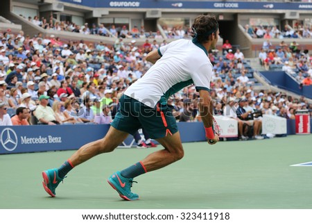 NEW YORK -SEPTEMBER 1, 2015: Seventeen times Grand Slam champion Roger Federer of Switzerland in action during his first round match at US Open 2015 at National Tennis Center in NY - stock photo