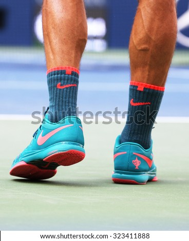NEW YORK - SEPTEMBER 1, 2015:  Seventeen times Grand Slam champion Roger Federer wears custom Nike tennis shoes during first round match at US Open 2015 at Billie Jean King National Tennis Center  - stock photo