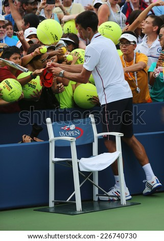 NEW YORK - SEPTEMBER 1: Six times Grand Slam champion Novak Djokovic signing autographs after US Open 2014 match at Billie Jean King National Tennis Center on September 1, 2014 in New York - stock photo