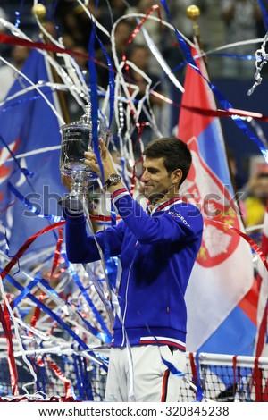 NEW YORK - SEPTEMBER 13, 2015: Ten times Grand Slam champion Novak Djokovic during trophy presentation after men's final match at US OPEN 2015 at Billie Jean King National Tennis Center in New York - stock photo