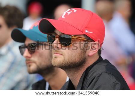 NEW YORK - SEPTEMBER 13, 2015: Tennis fans wears Roger Federer's hat during US Open 2015 match at Billie Jean King National Tennis Center in New York - stock photo