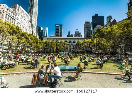 NEW YORK - September 24th: People enjoying a nice day in Bryant Park on September 24th, 2013 in New York City, NY. Bryant Park is a 9,603 acre privately managed park in the center of Manhattan.