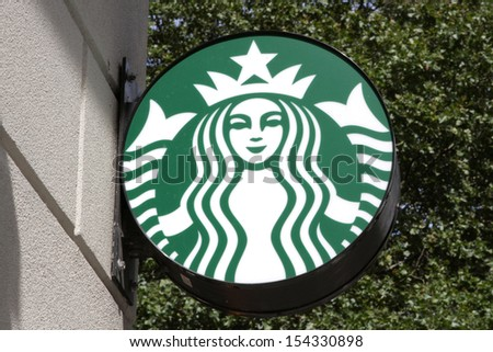 NEW YORK - SEPTEMBER 15: The exterior of a Starbucks location on September 15, 2013 in New York City. Starbucks is the largest coffeehouse company in the world with stores in more than 60 countries.  - stock photo